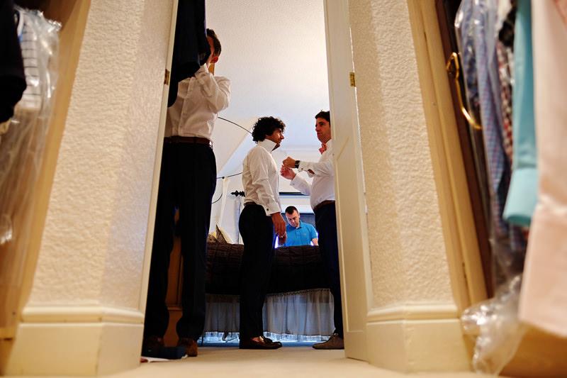 groom prep low getting dressed