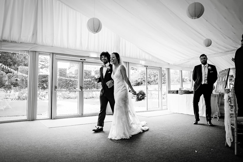 Bride and Groom enter the marquee at The Heath House