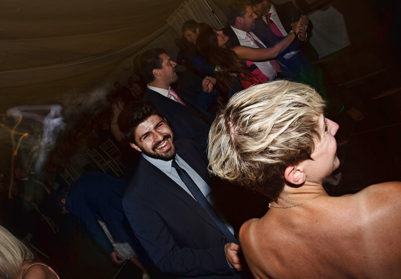 Dance floor with peple smiling and dancing