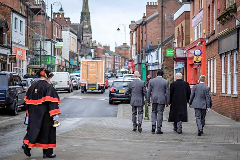 groom and ushers on way to pub in leek