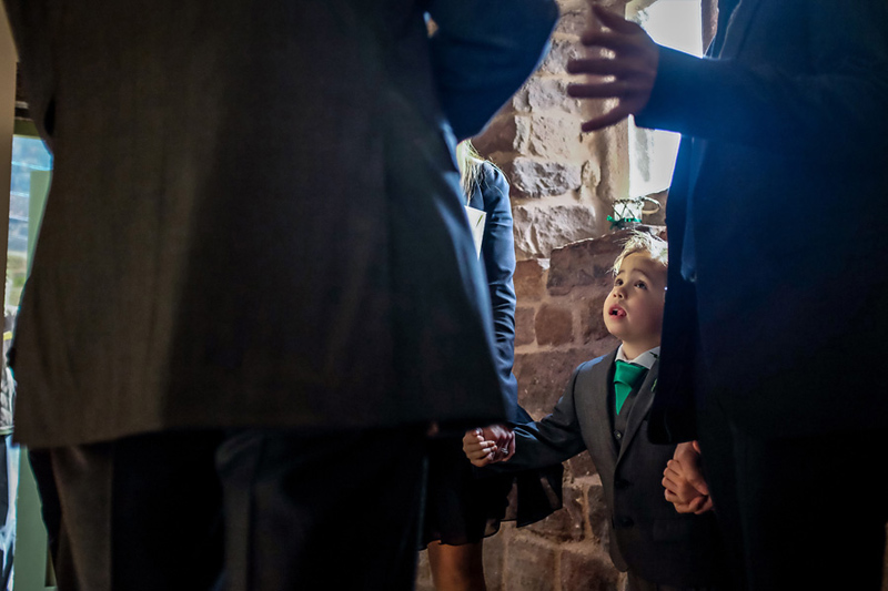 guests mingling in the ashes barn at a wedding