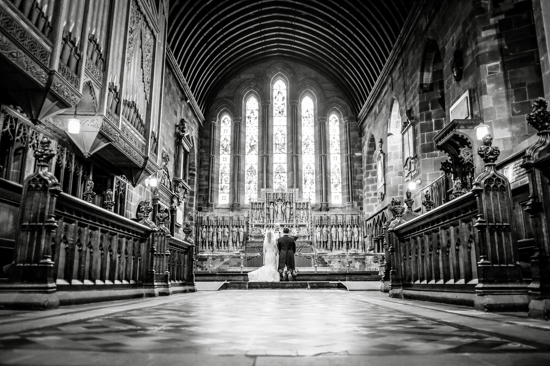 Epic church with a bride and groom getting married during a summer wedding.