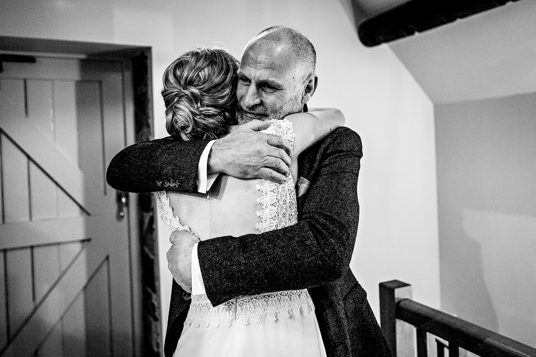 The dad hugging the bride on her wedding day