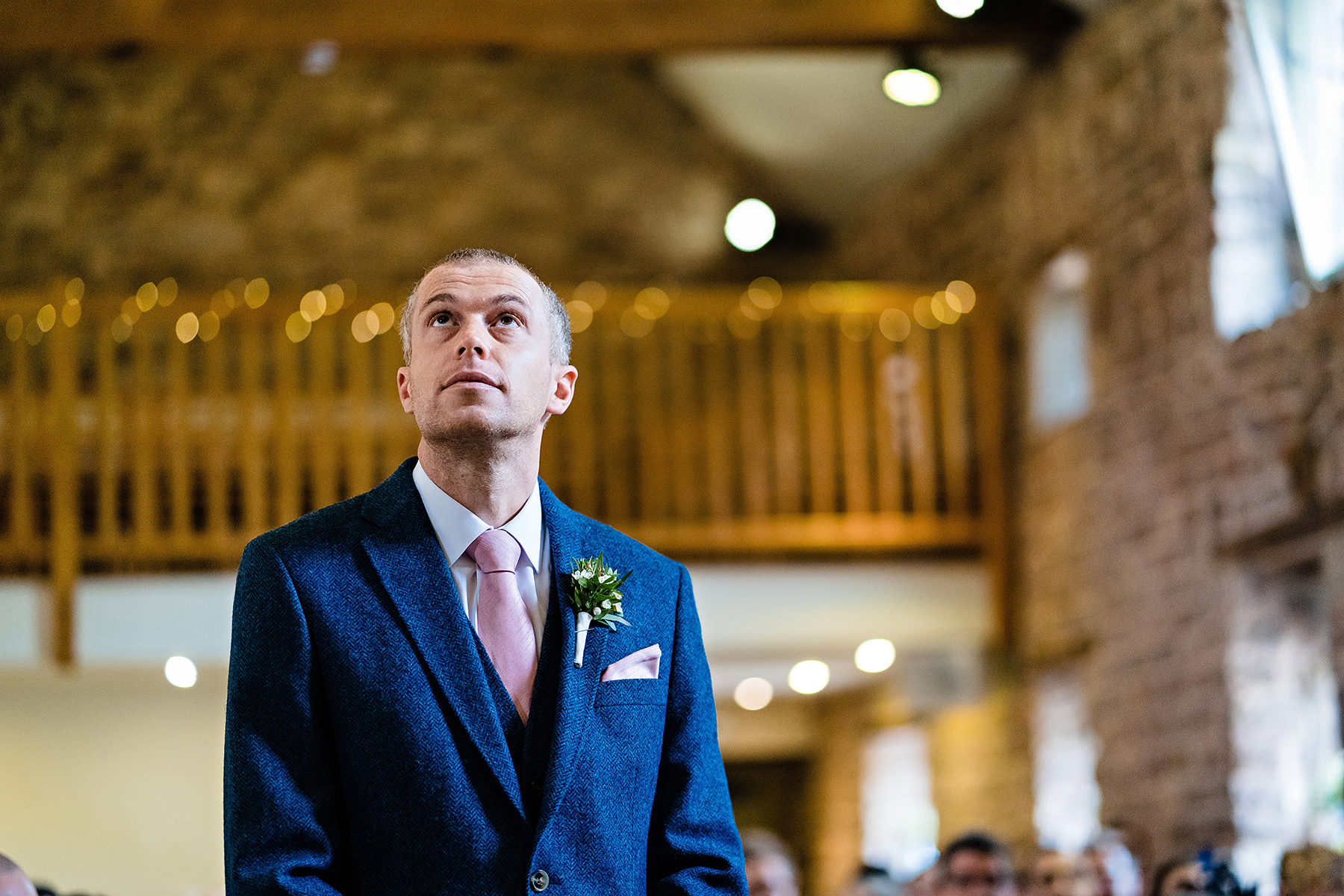 Wedding photography of the groom awaiting the bride