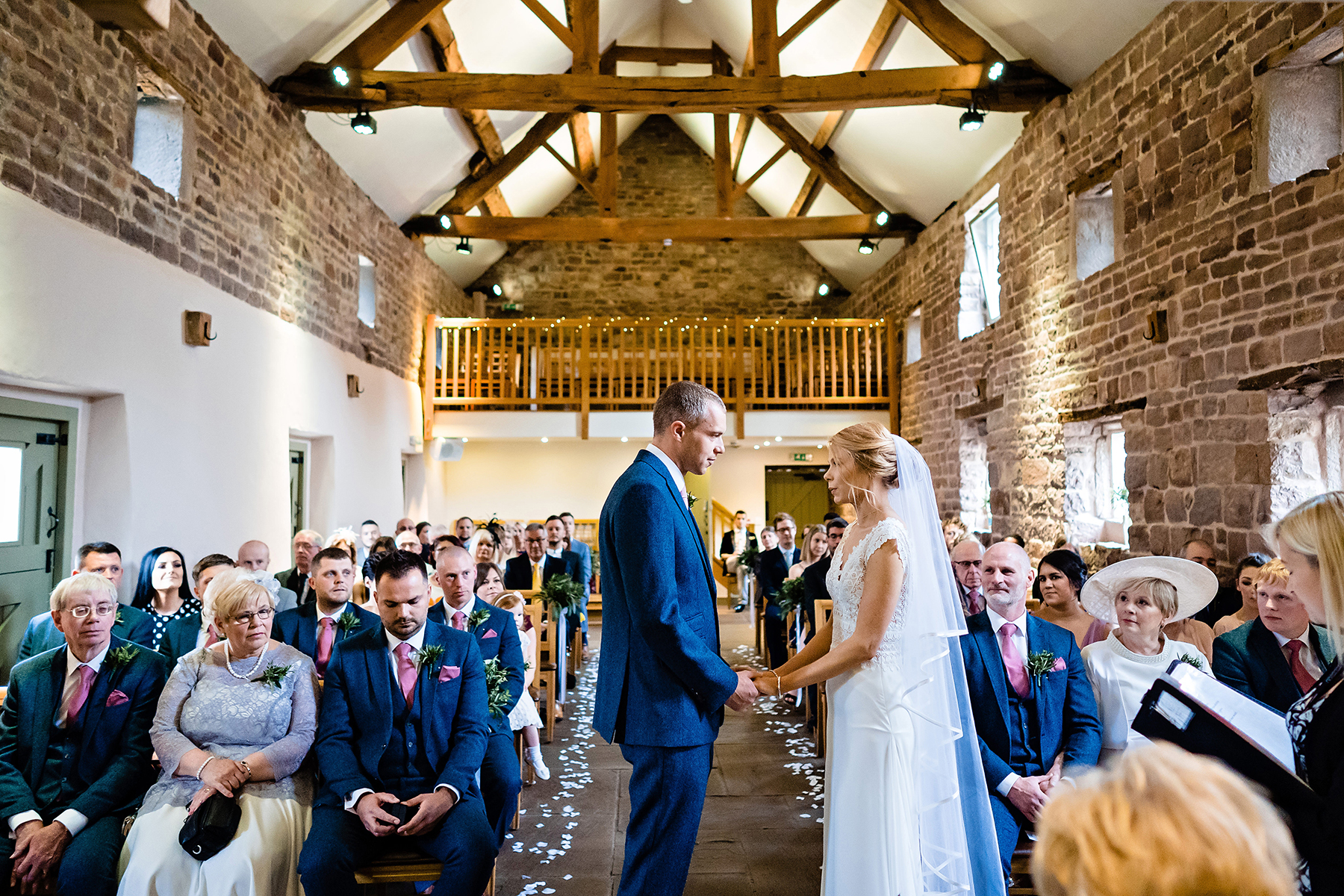 wide angle wedding photography of the ashes wedding barn during a wedding ceremony