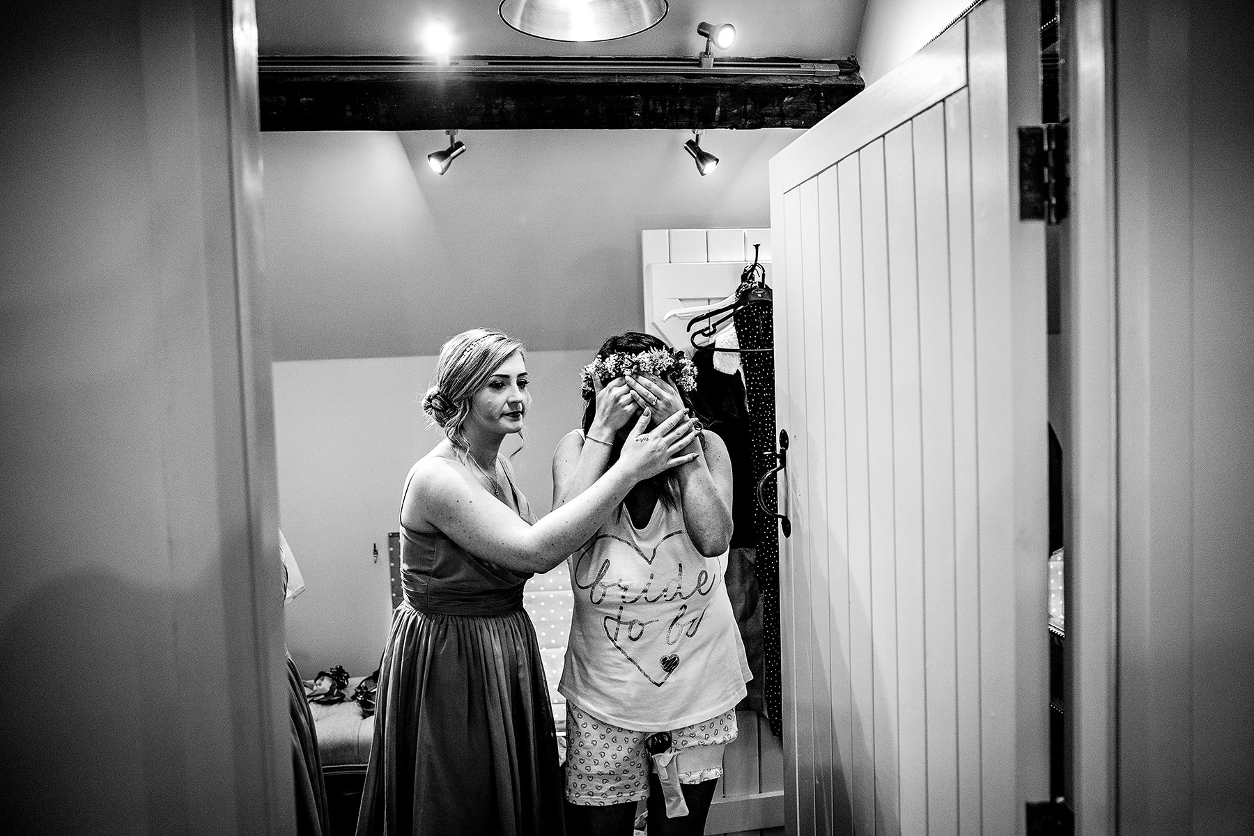 bride with her eyes closed in the prep room