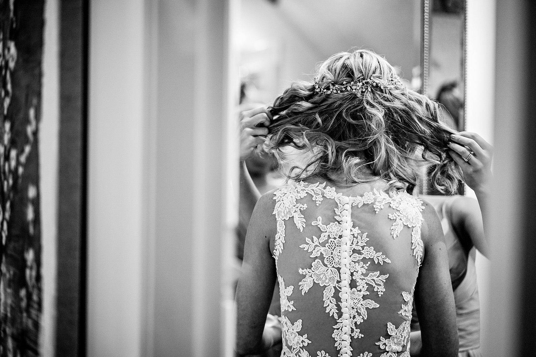 a shot of the back of the brides dress