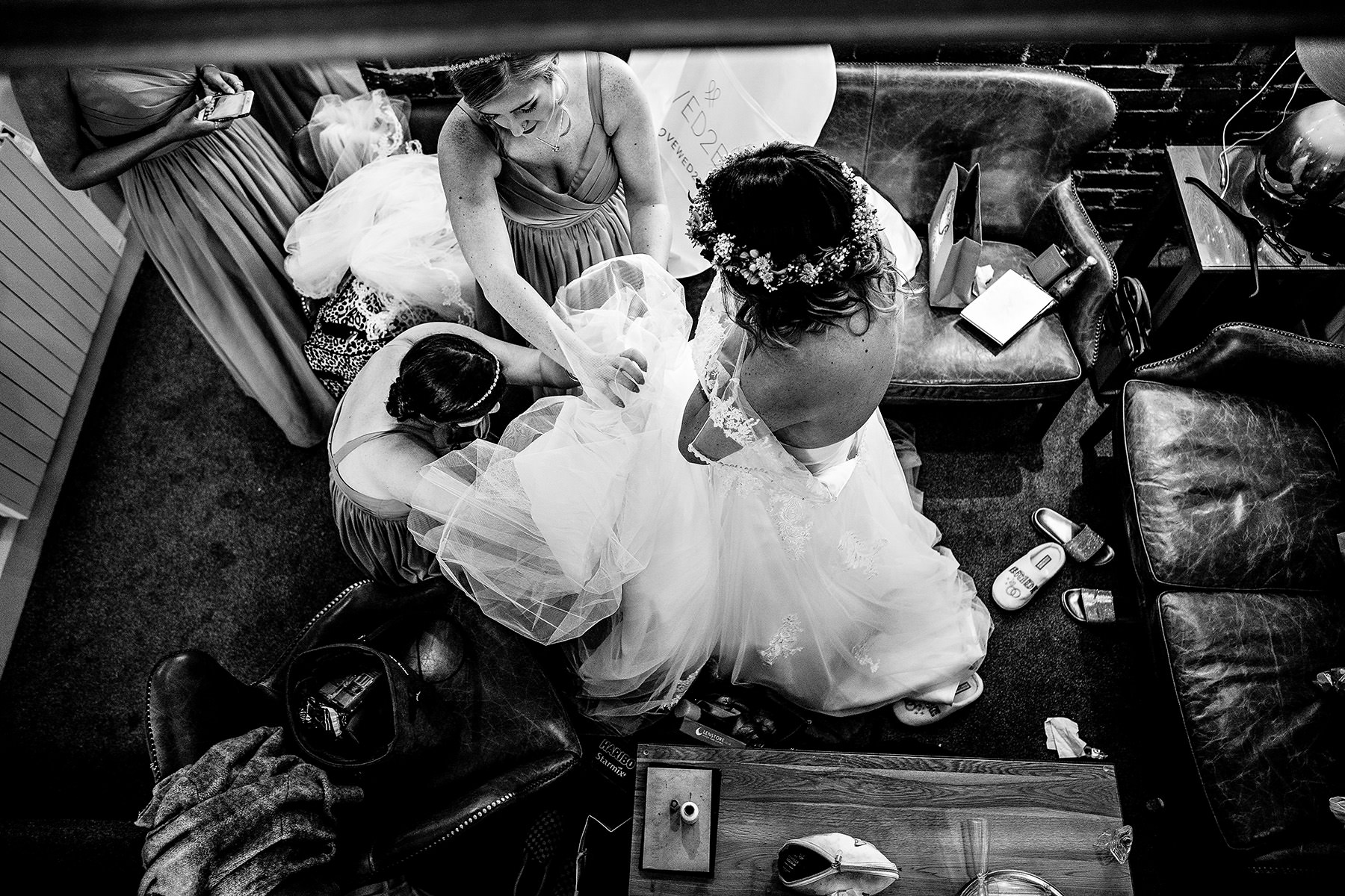 aerial shot of bride getting into her dress