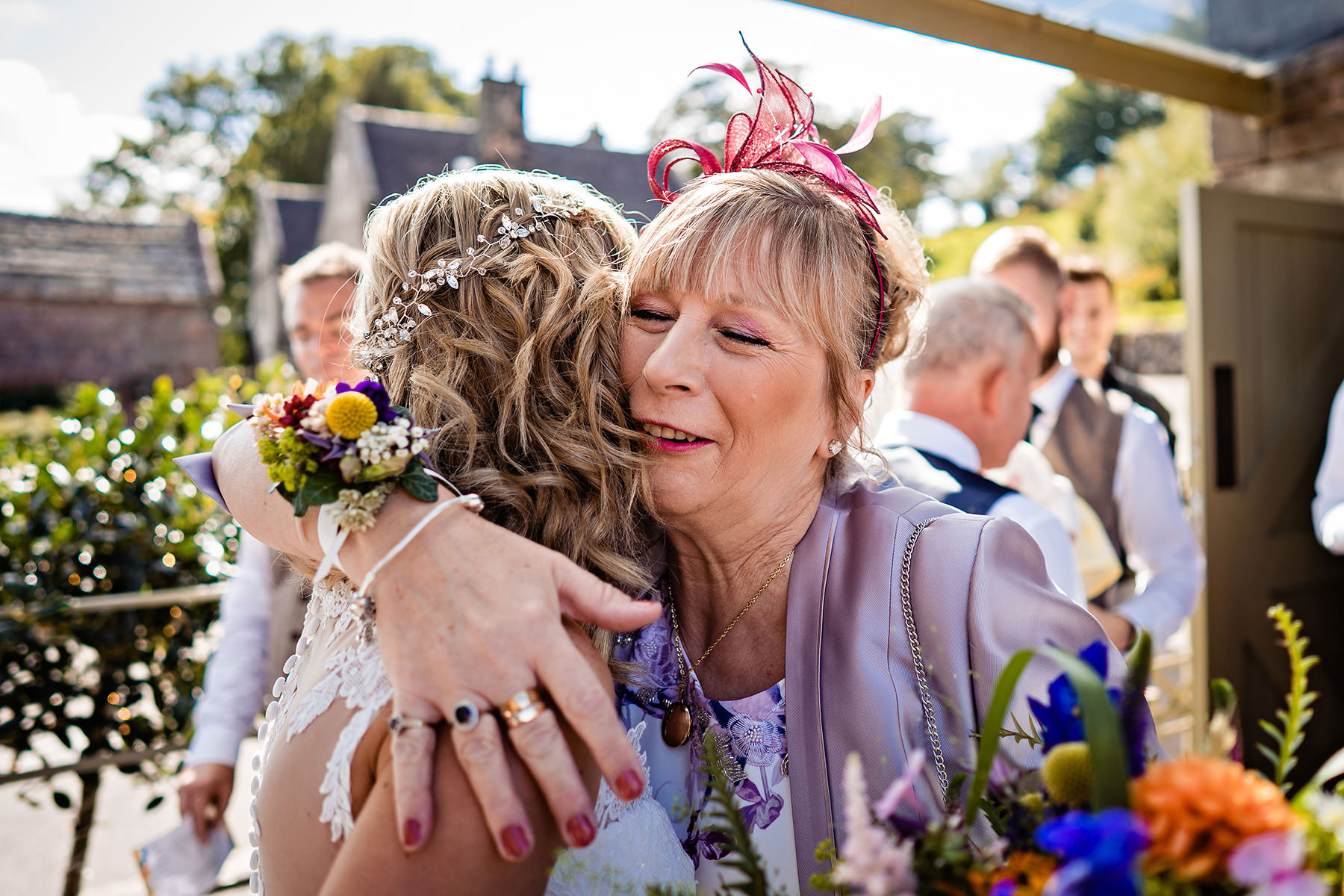 mum hugging her daughter after just getting married