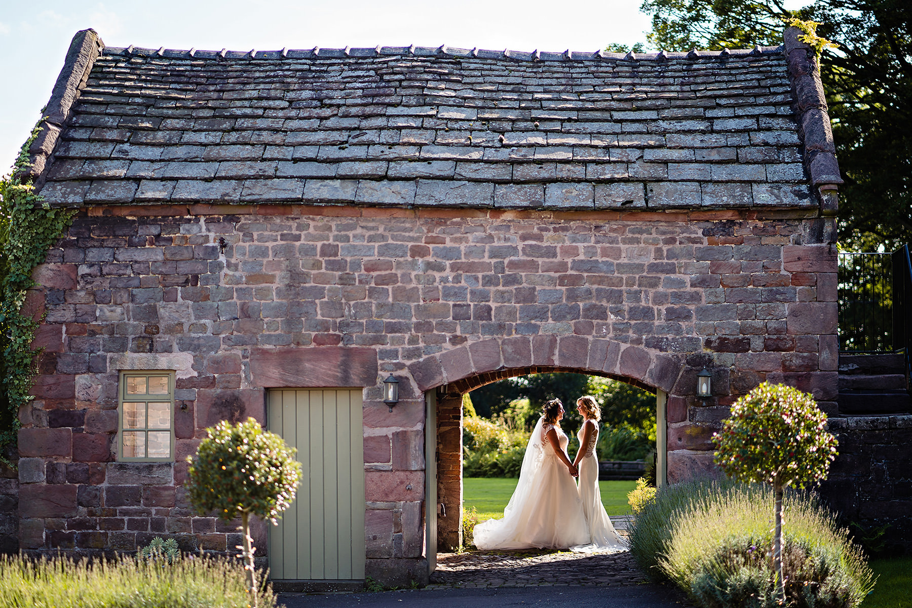 The ashes Coach house with two brides in the arch