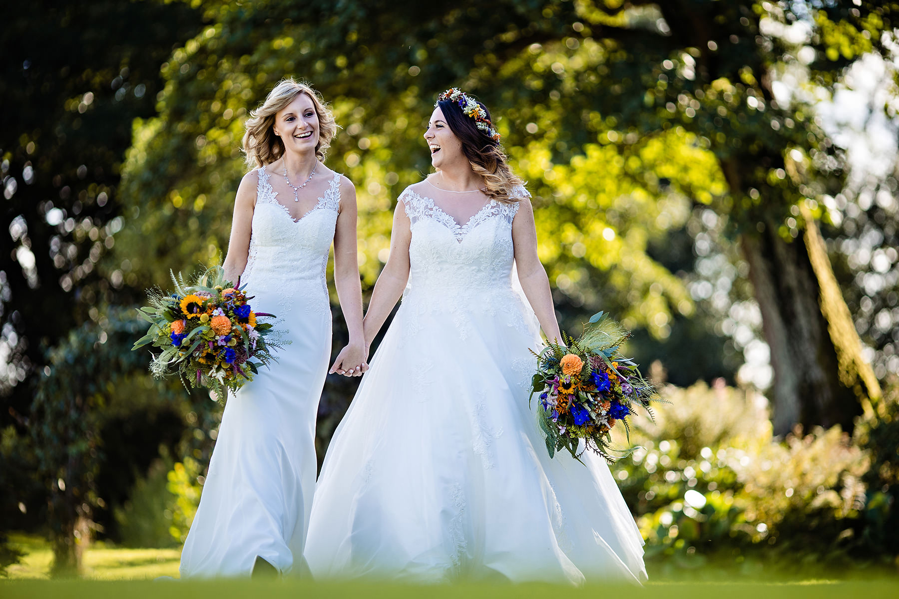 The brides walking across the grass