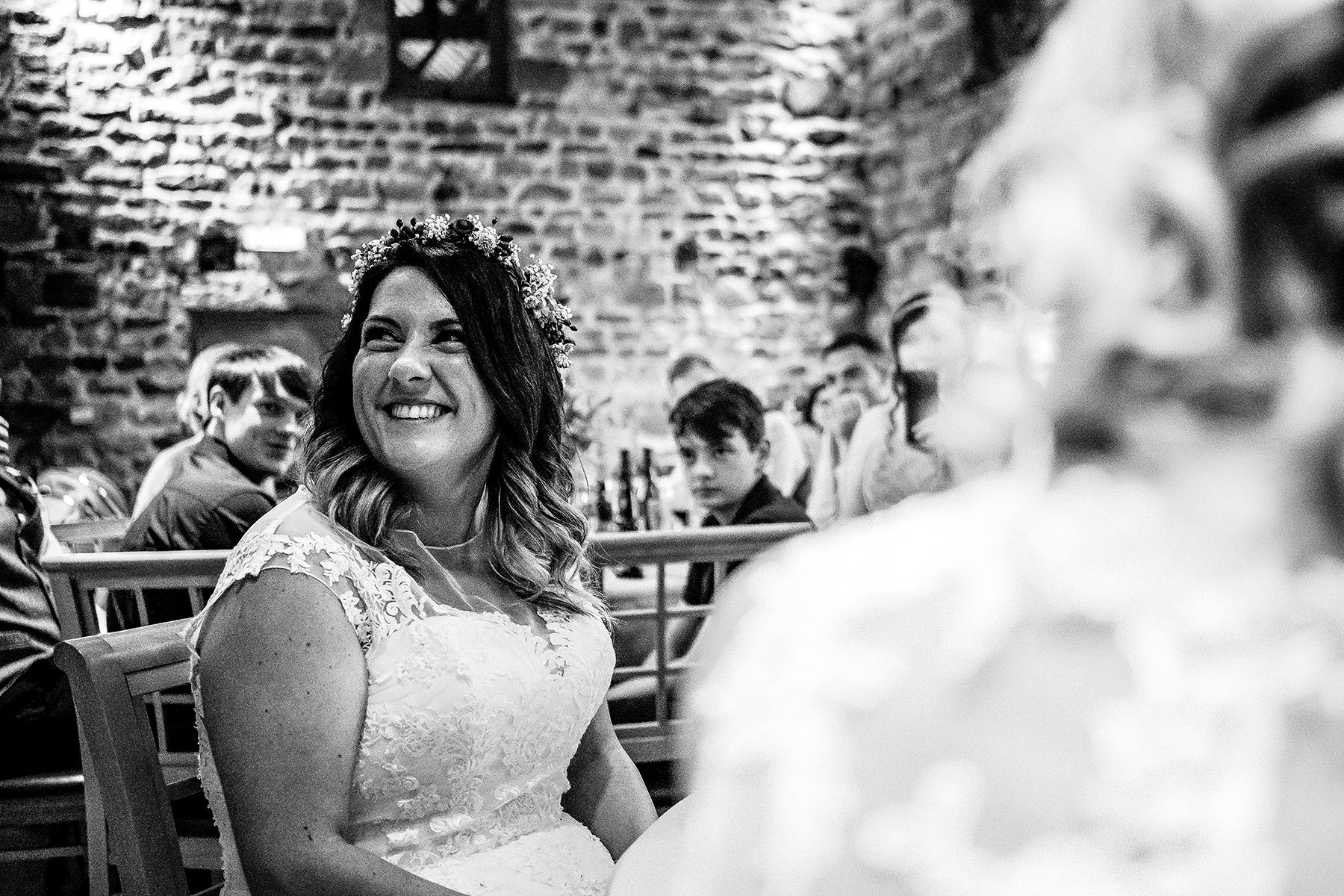 one of the brides enjoying the speeches