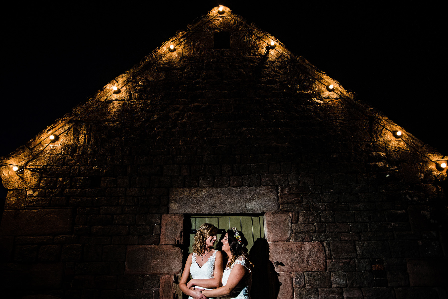 the brides outside in a night lit shot