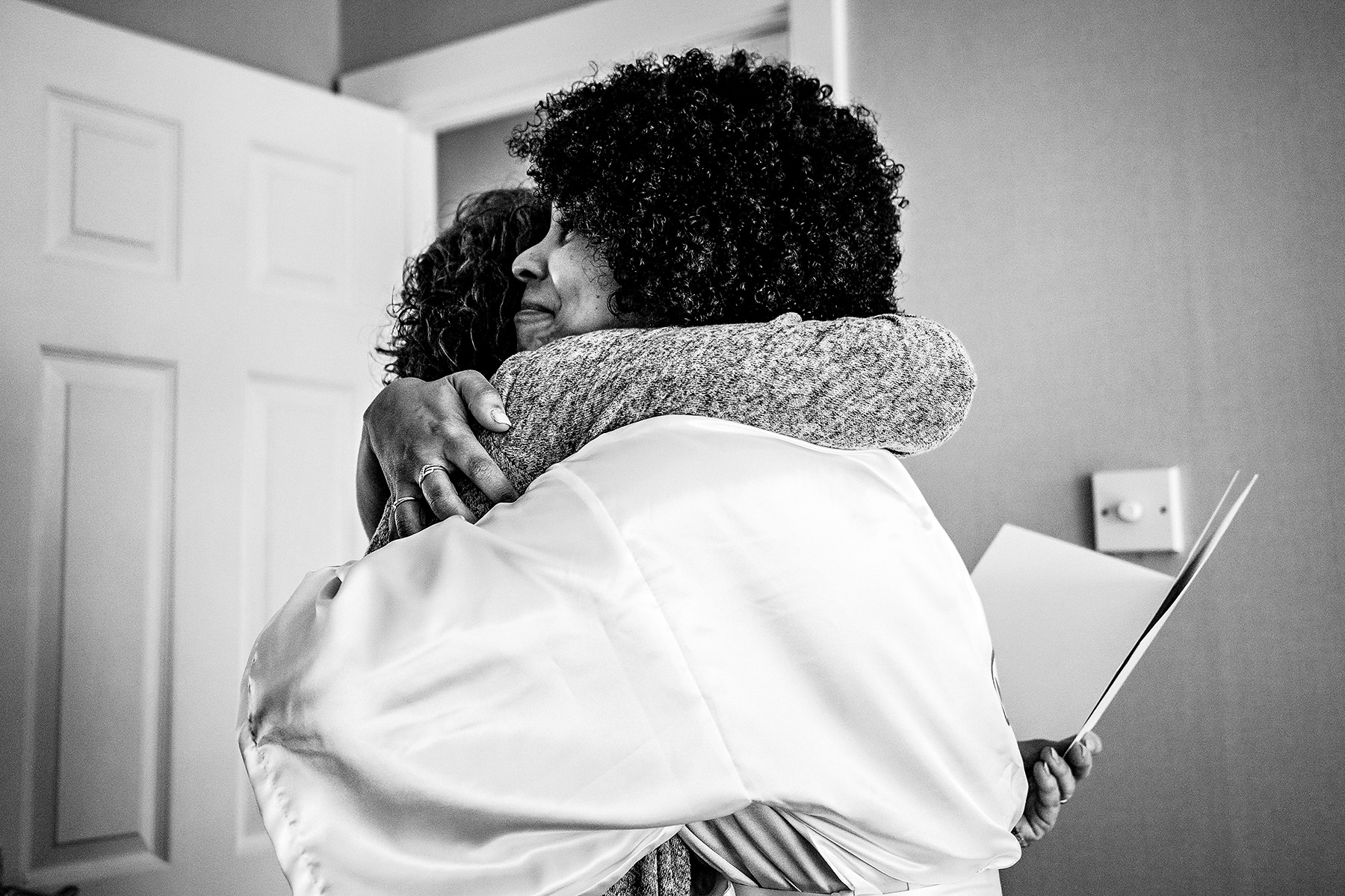 mother of bride hugging the bride