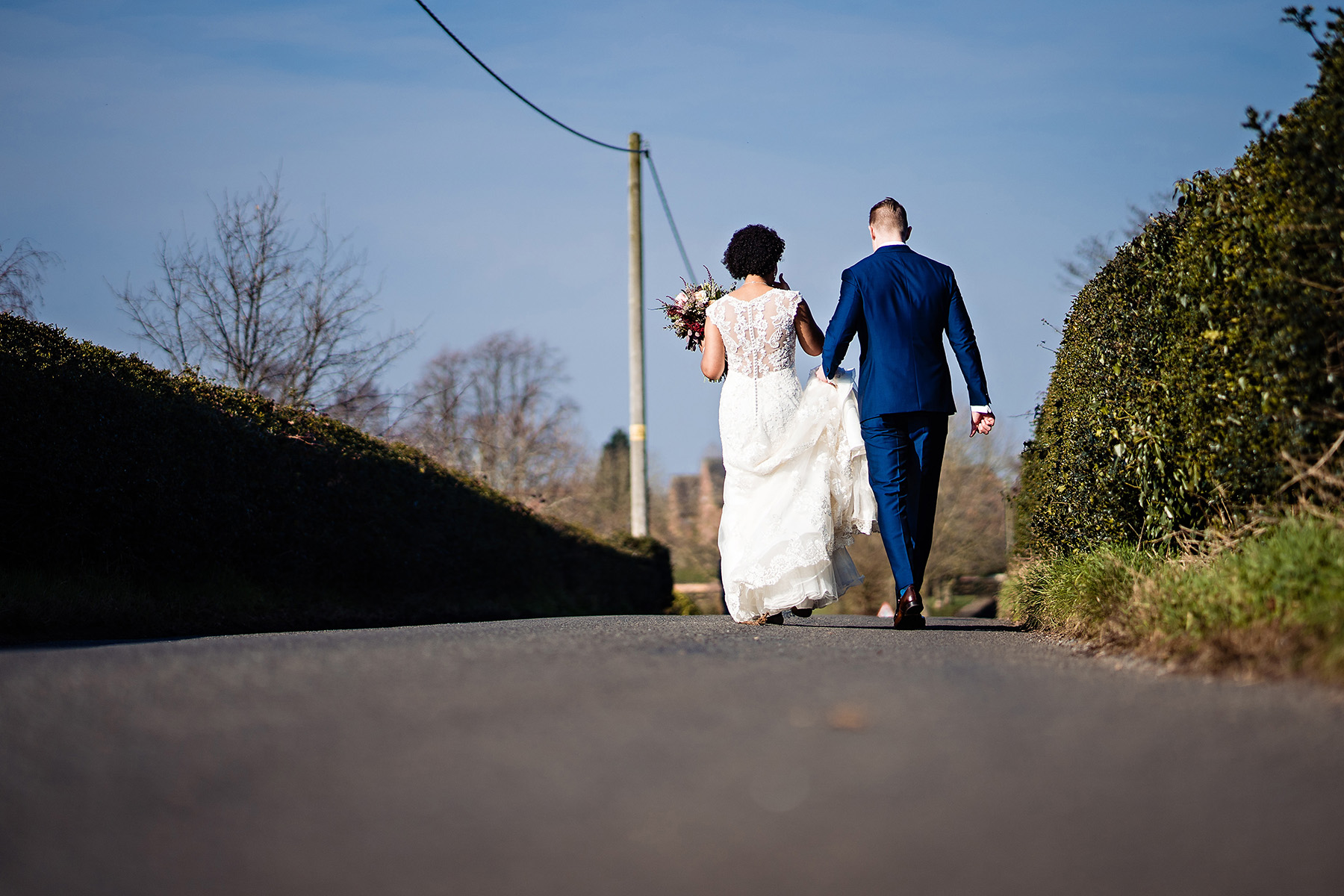 bride and groom head to The Moat House, Acton Trussell