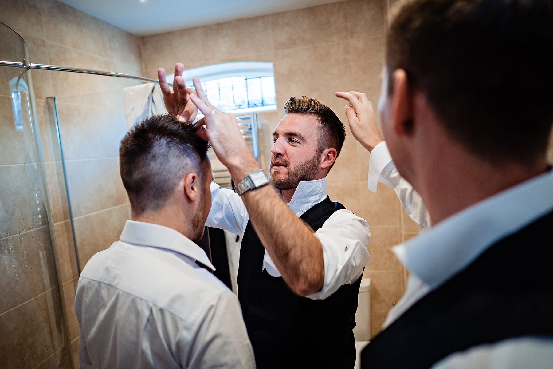 groomsmen doing their hair