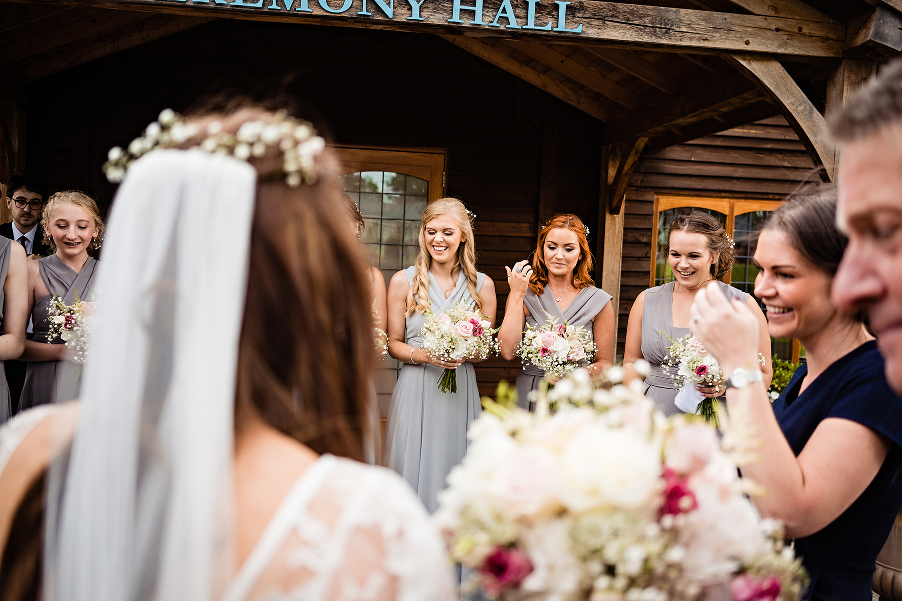 bridesmaids awaiting bride at the ceremony barn