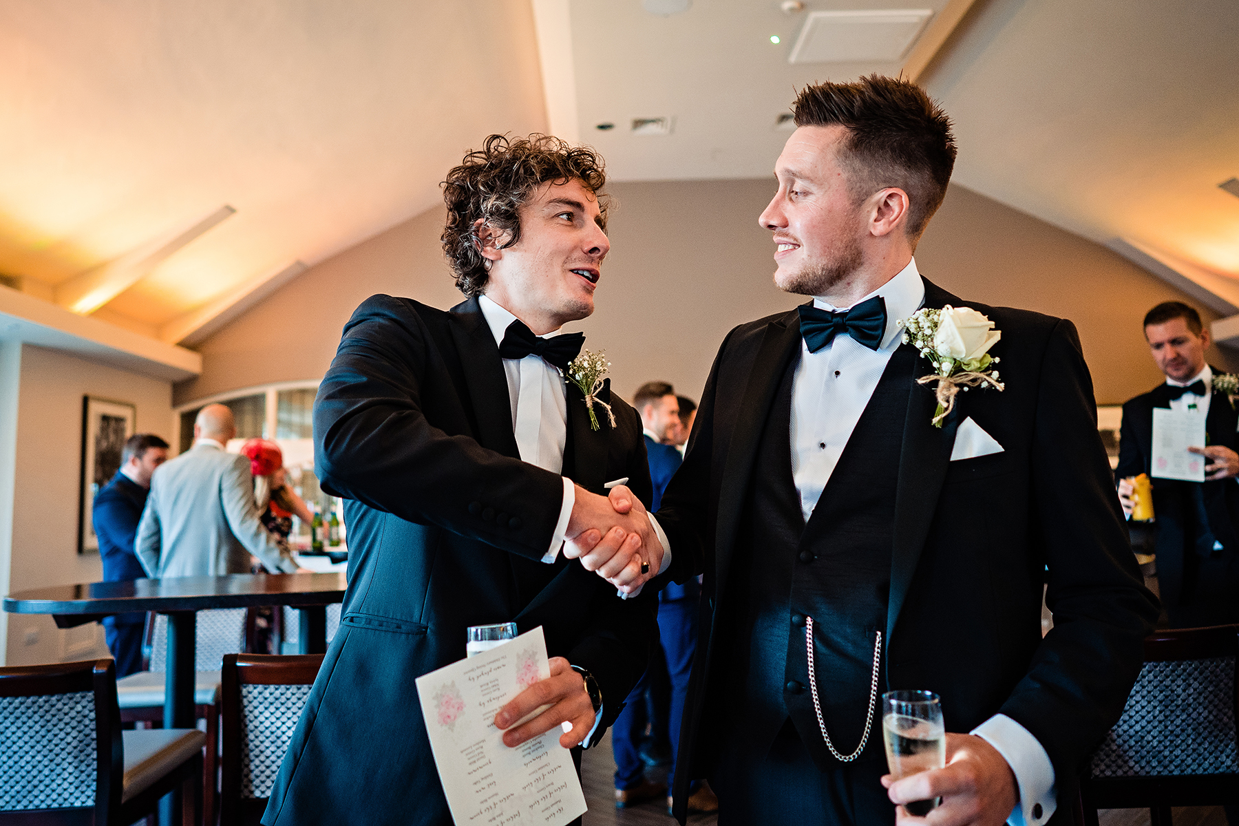 groom shaking hands with a groomsman