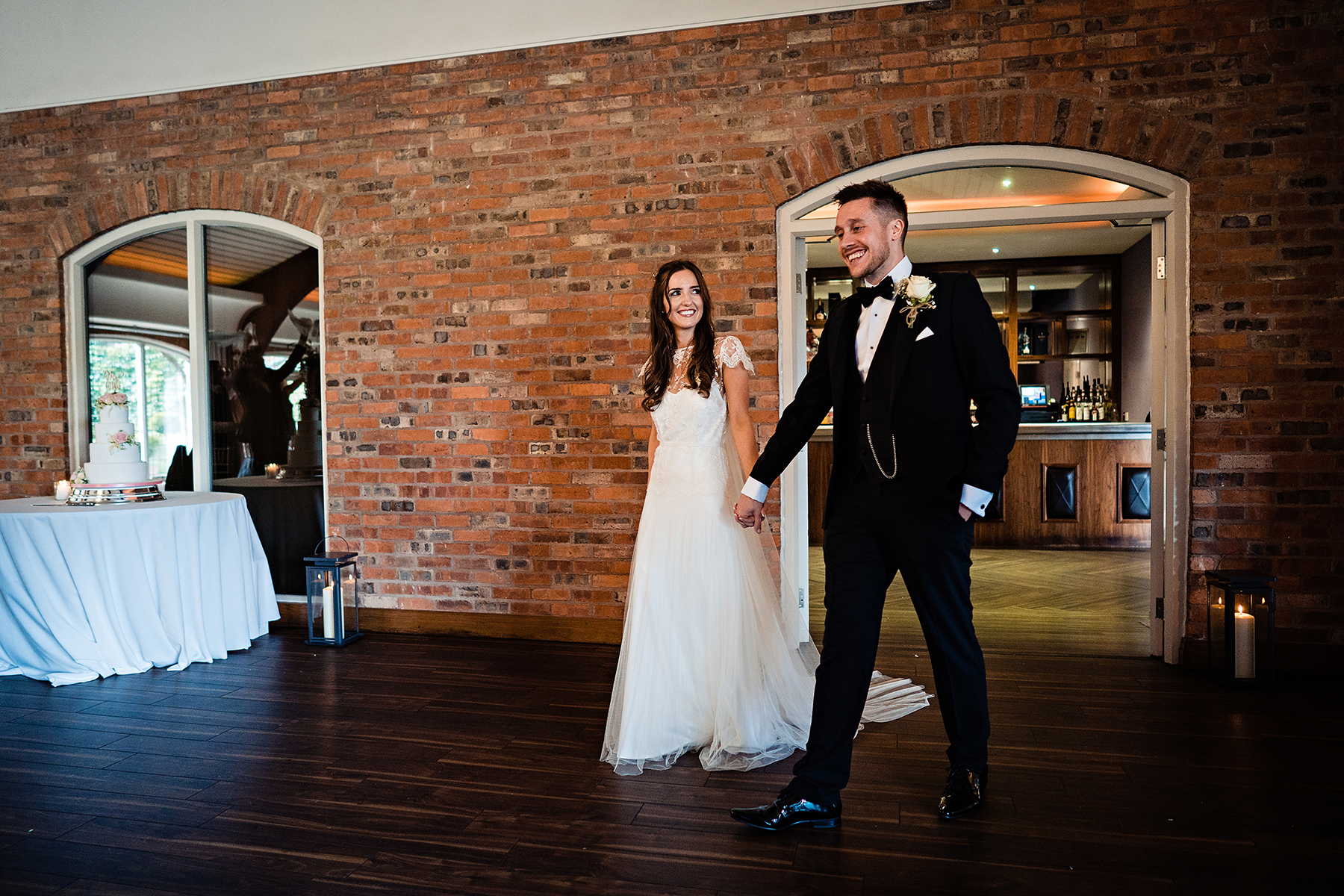 the couple walking into the reception room