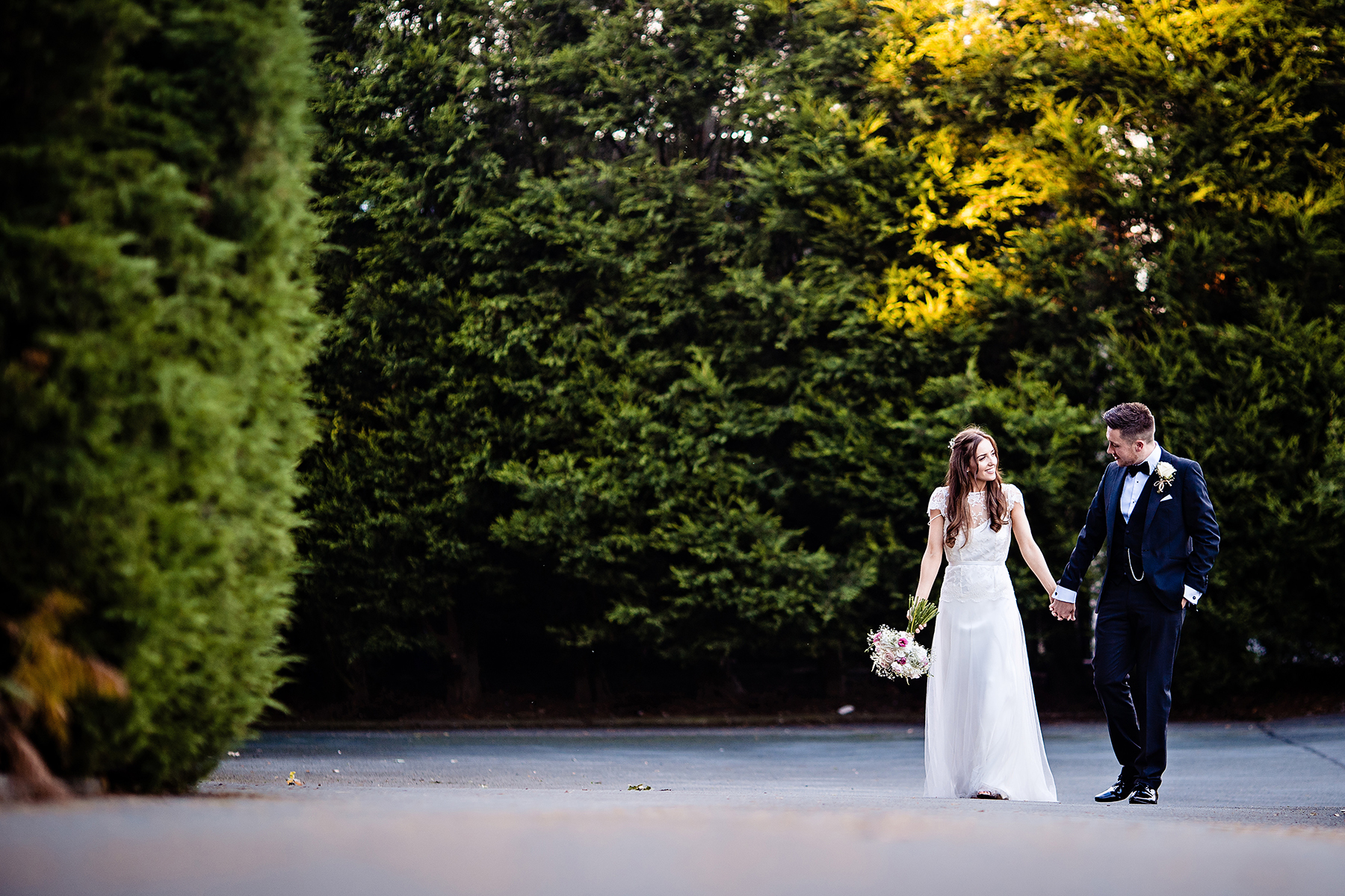 a natural picture of the bride and groom walking