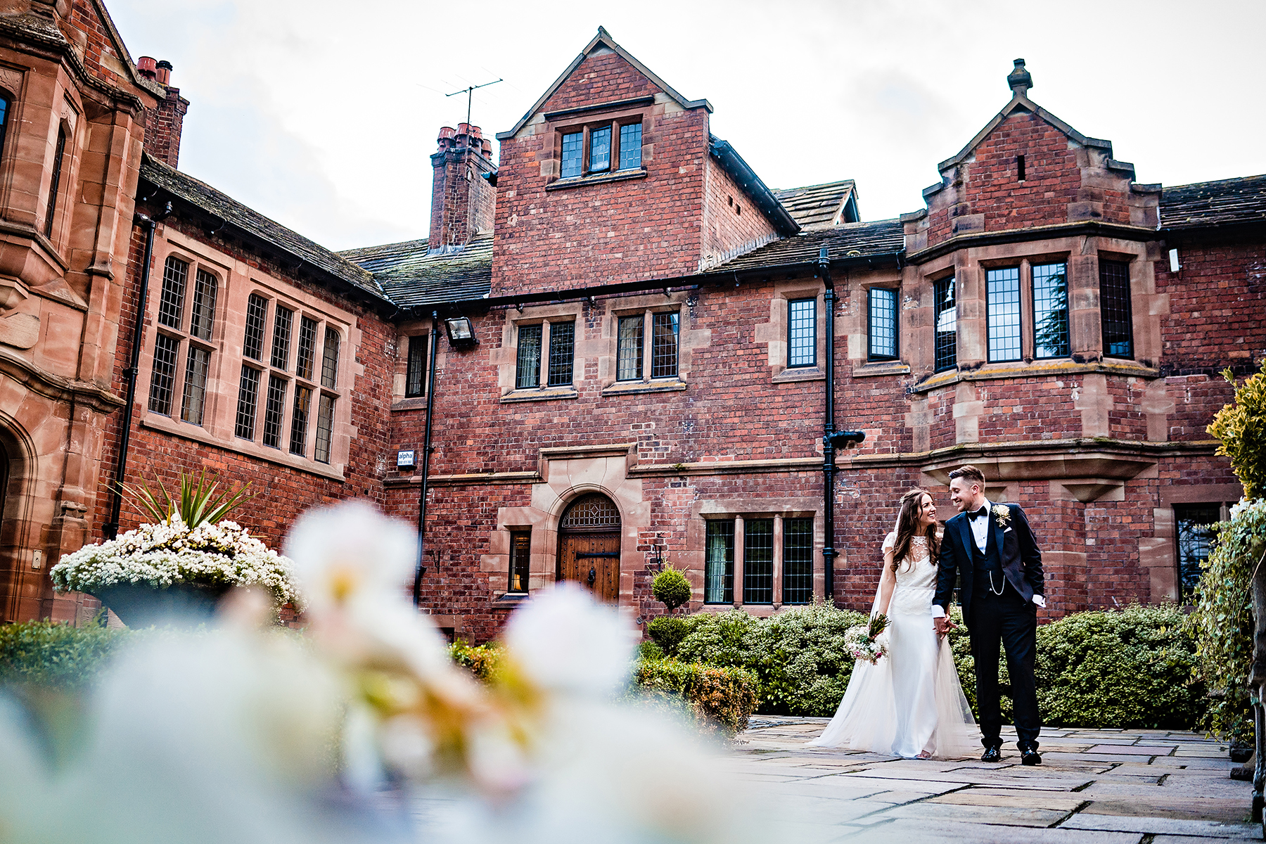 bride and groom happy outside Colshaw Hall