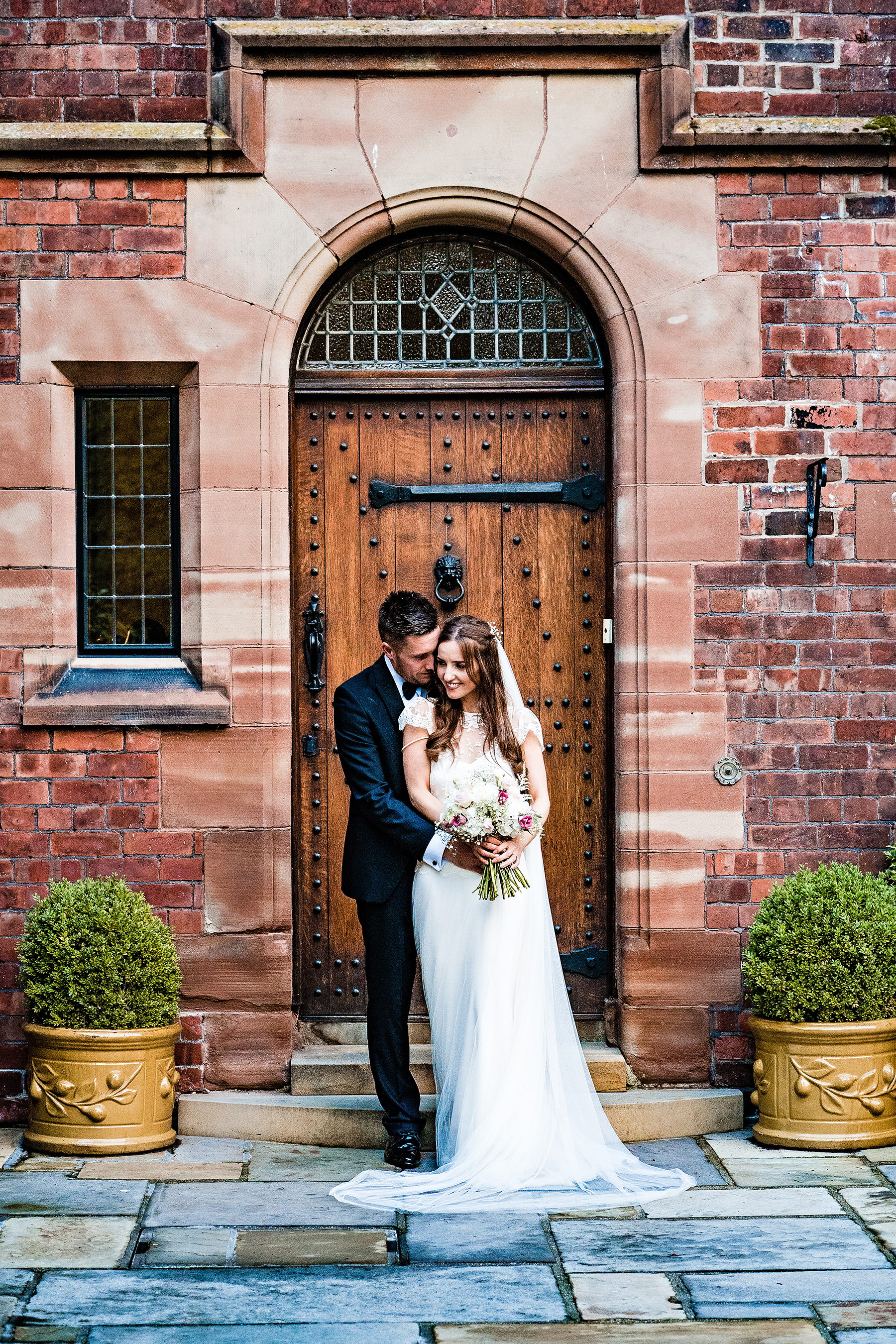 bride and groom at colshaw hall outside