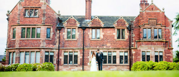 bride and groom walking outside at a wedding at Colshaw Hall, Cheshire