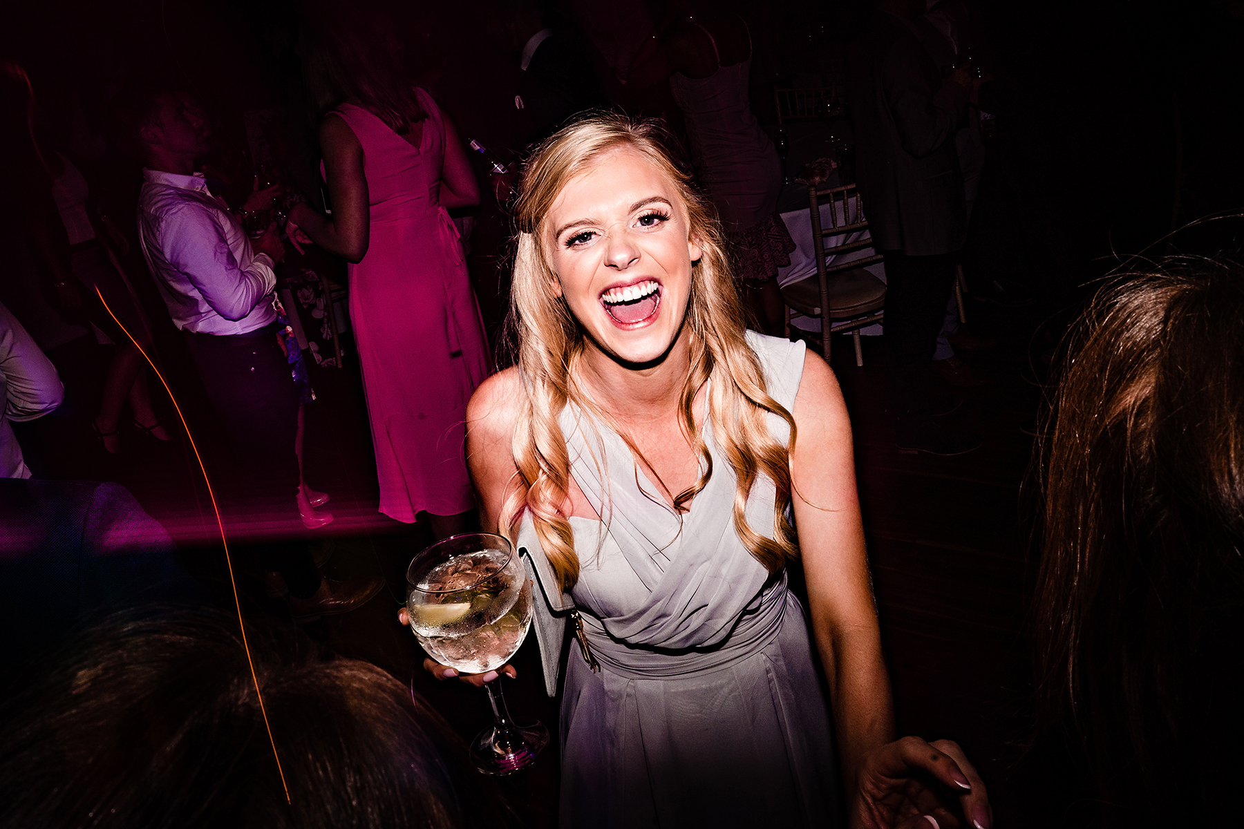 a bridesmaid with a drink in her hand