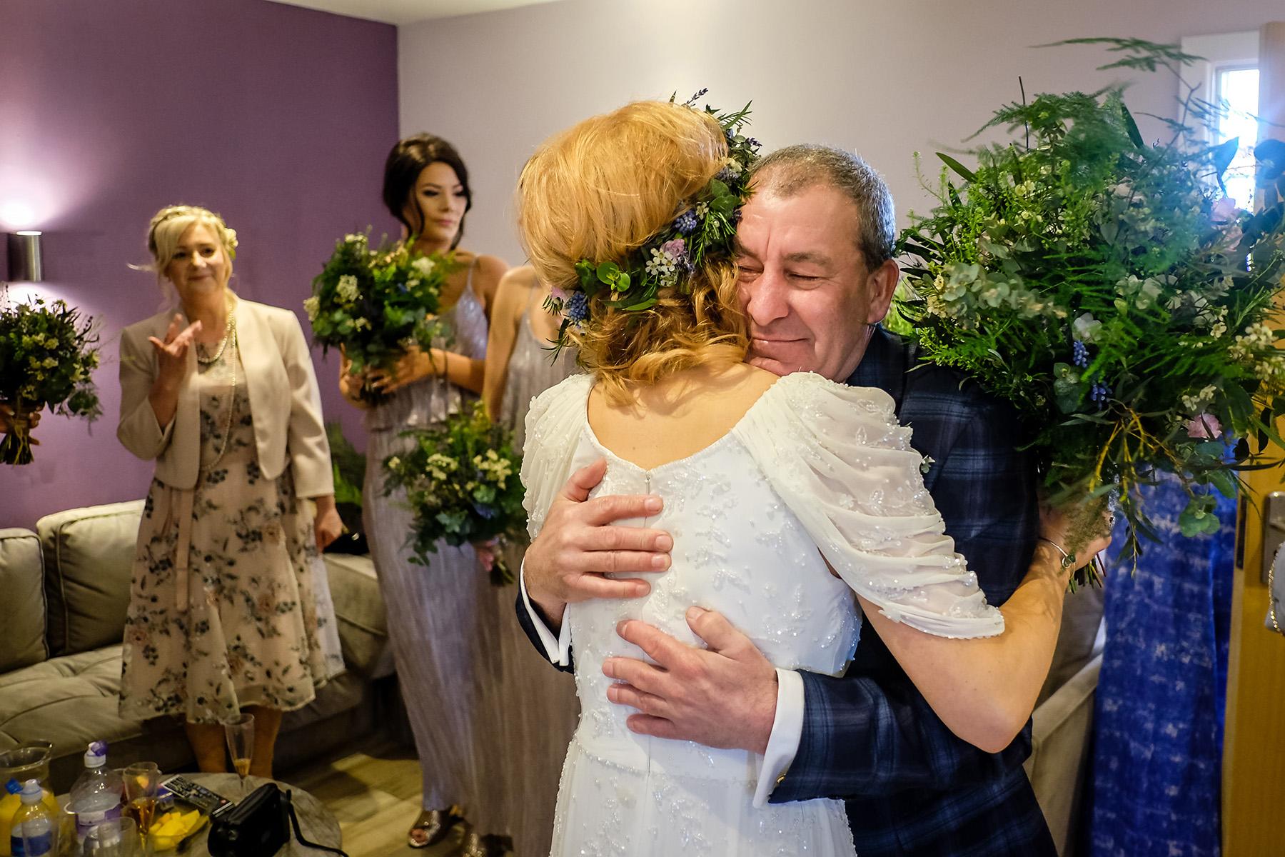 Dad hugging bride at Aston Marina