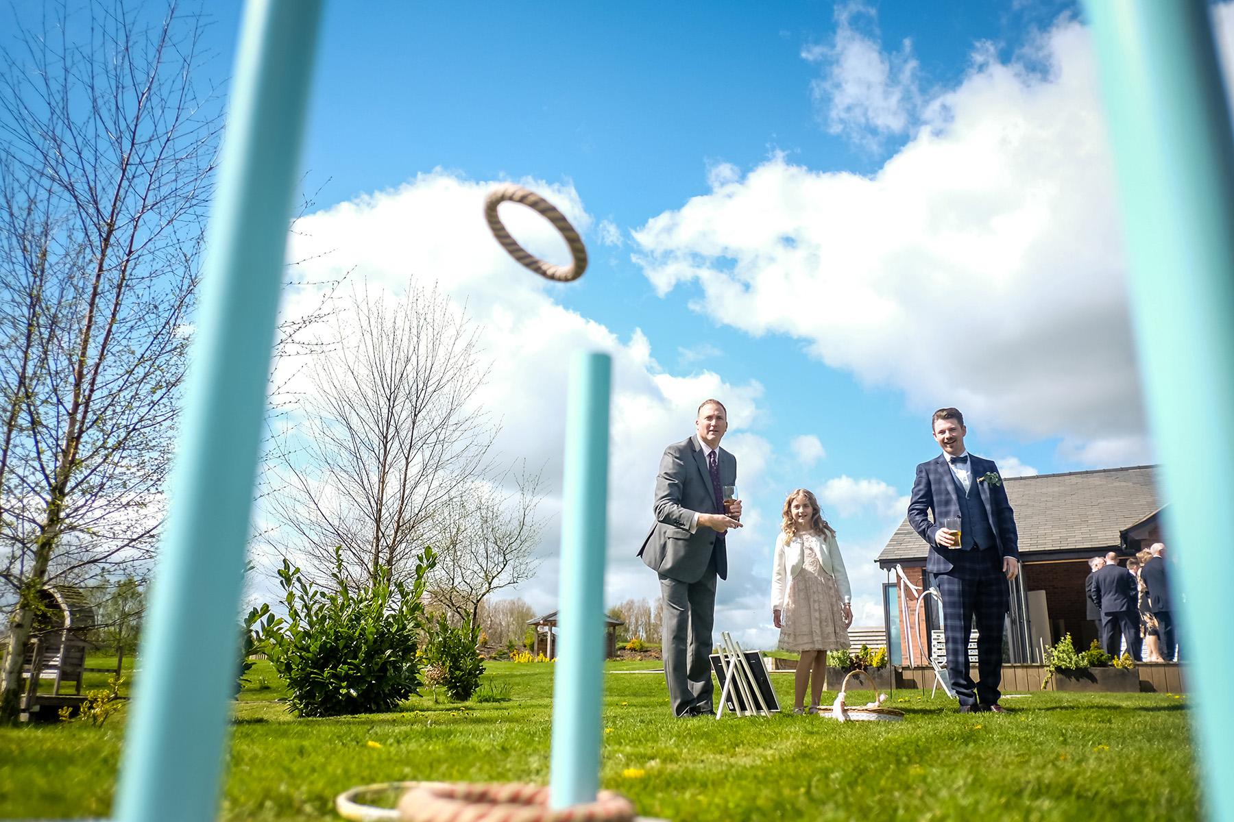 guests enjoying lawn games at Aston Marina