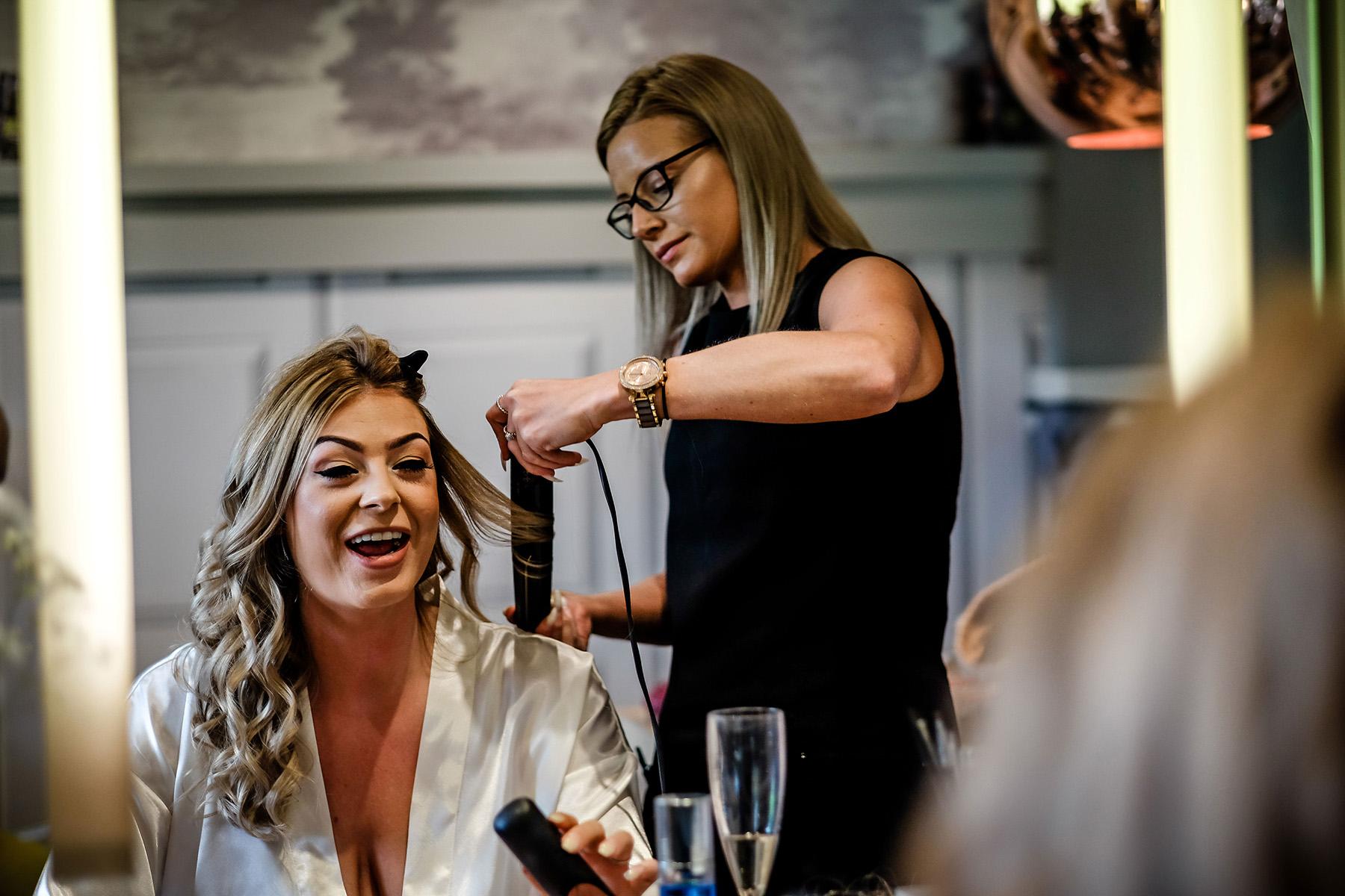 bride having hair done at Moddershall Oaks