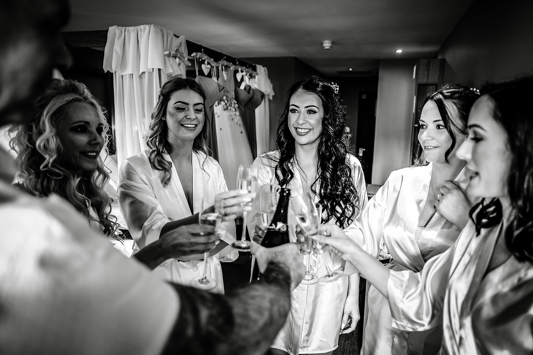 all the bridal party drinking wine