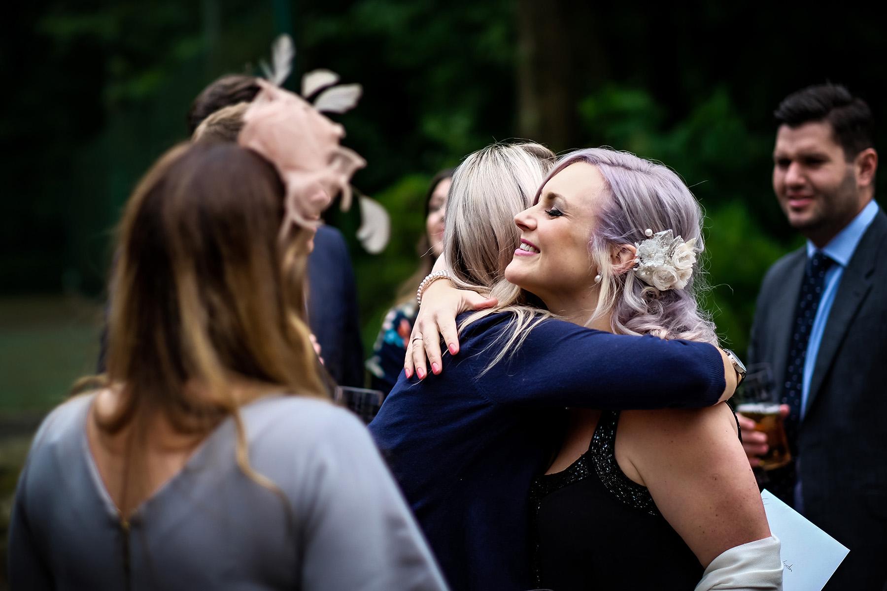 hugs at a Moddershall Oaks wedding