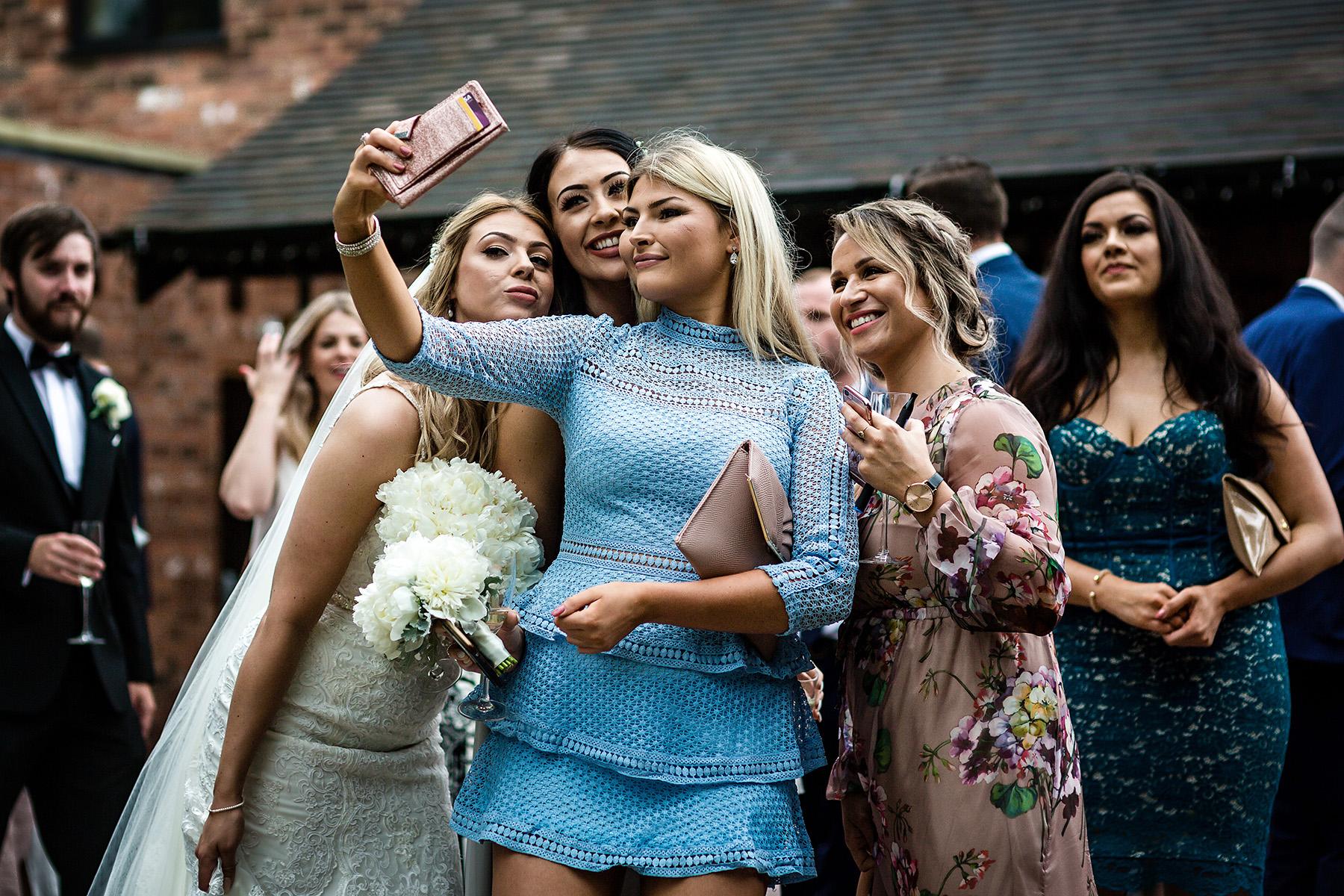 a group selfie at a Moddershall Oaks wedding