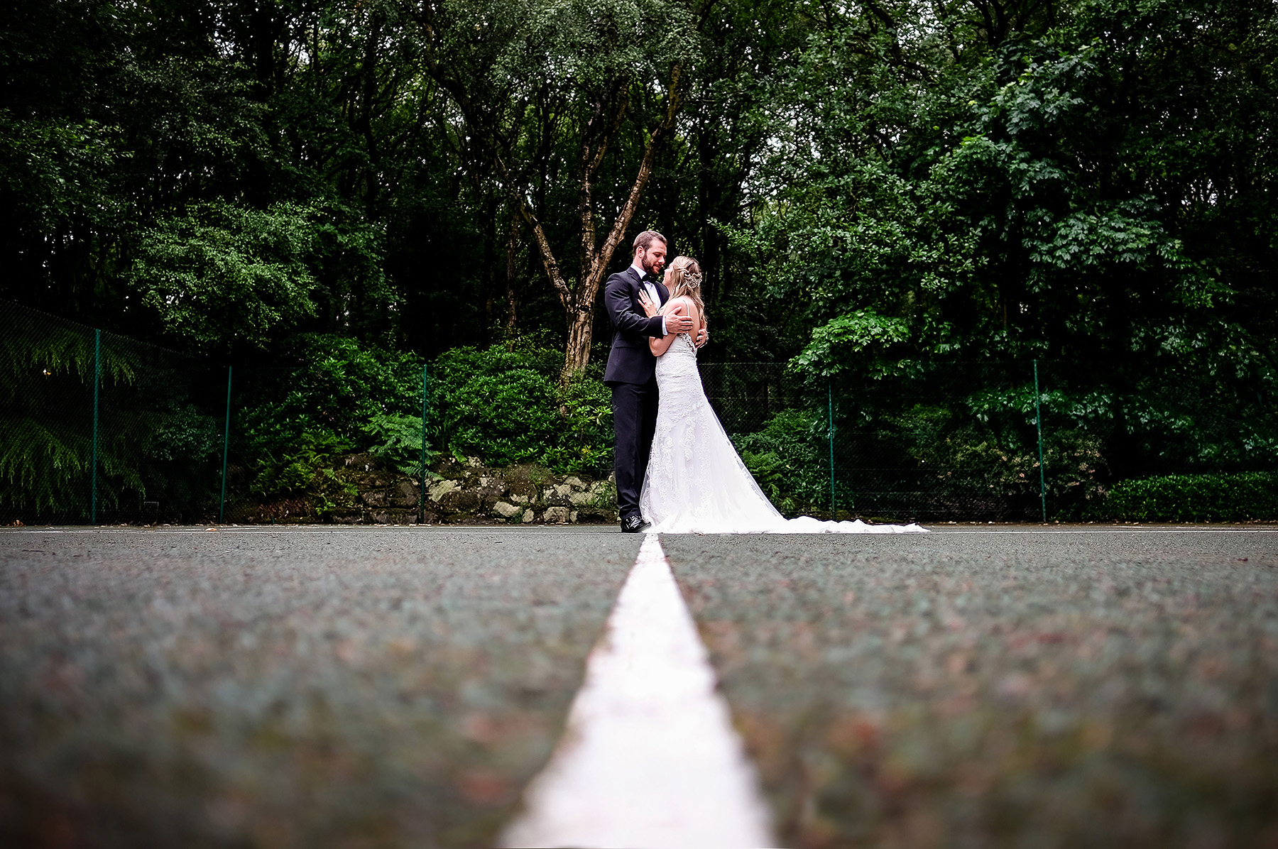 couple portrait on a tennis court at Moddershall Oaks wedding