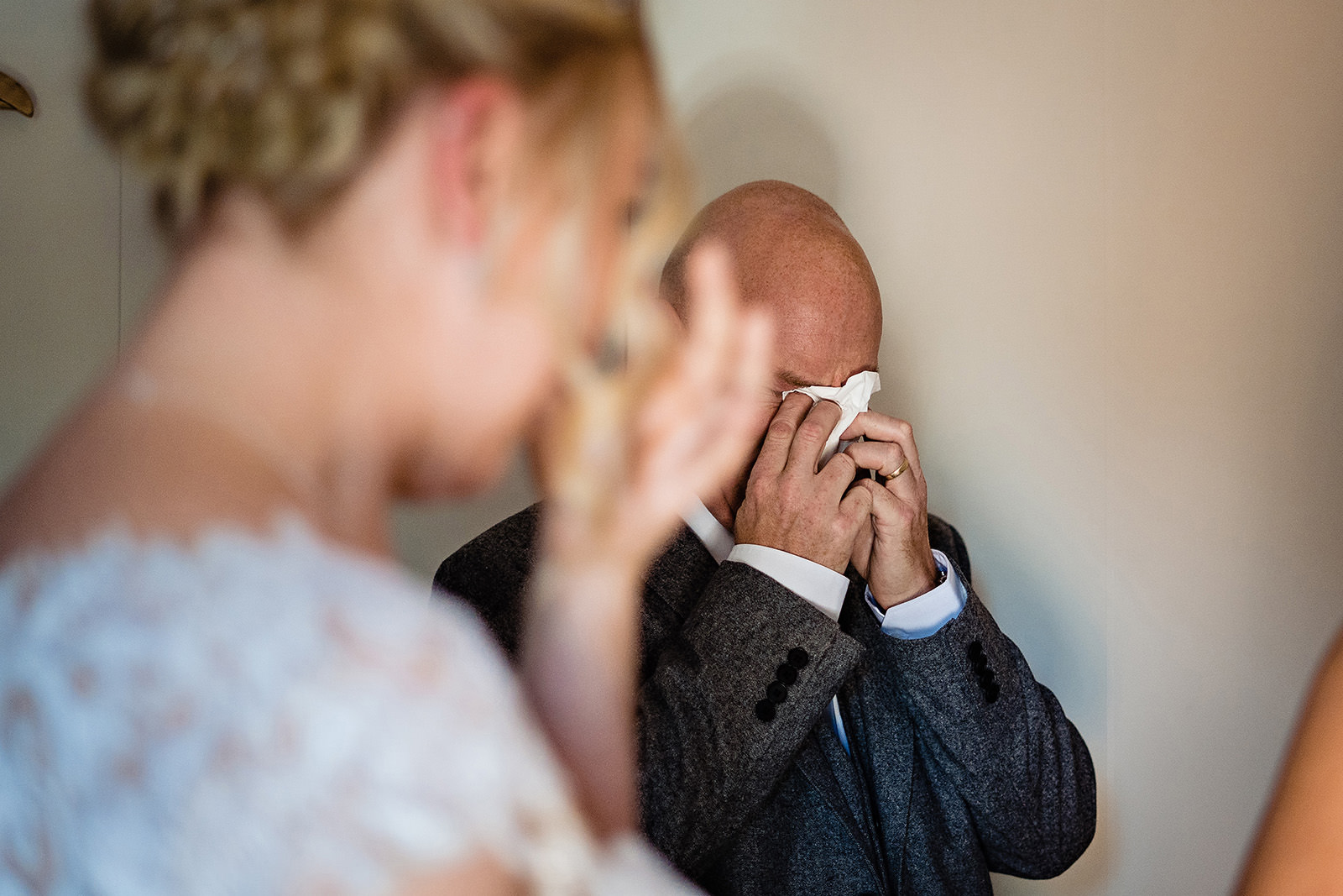 dad crying with bride