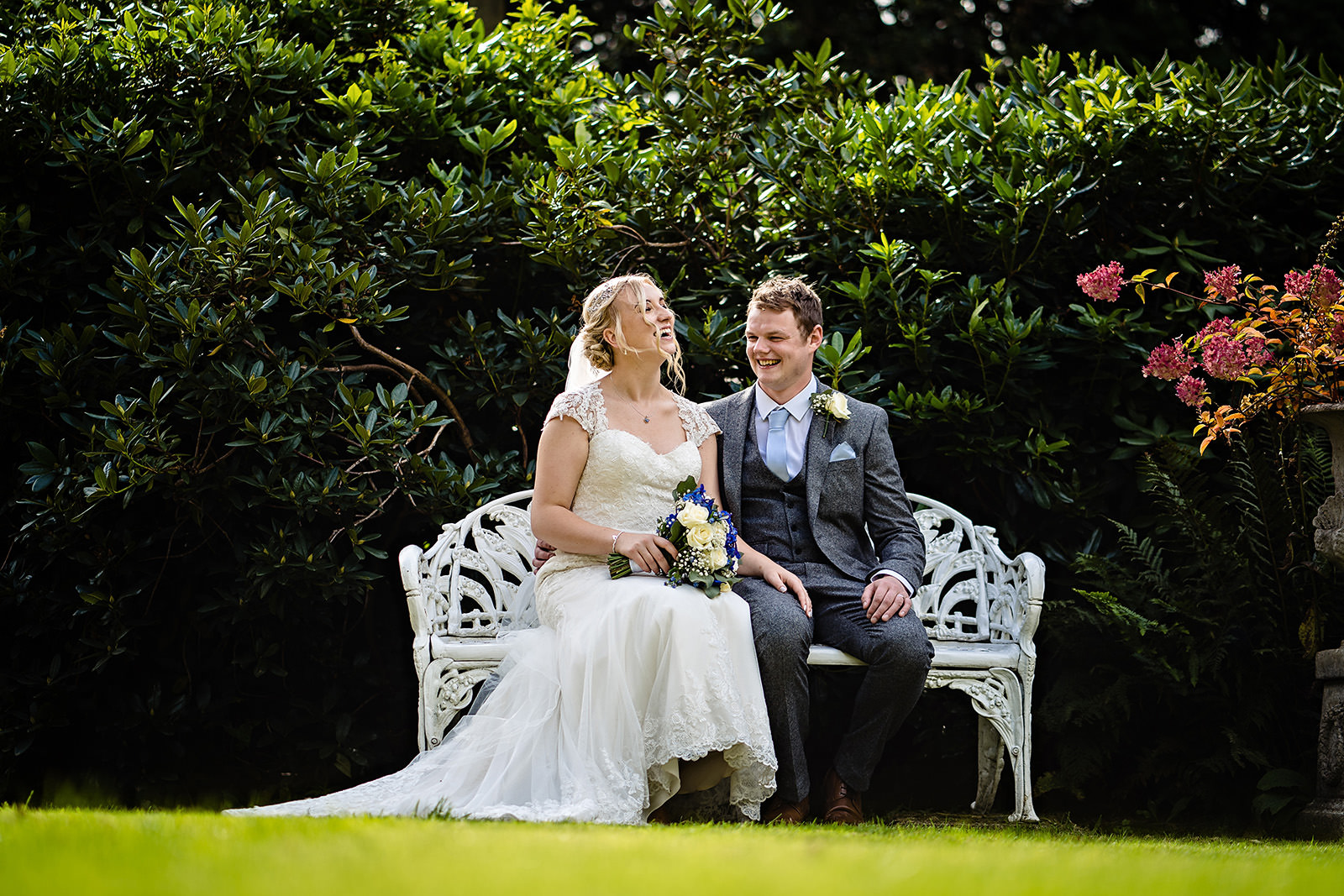 bride and groom sitting at Dunwood Hall Wedding Photography
