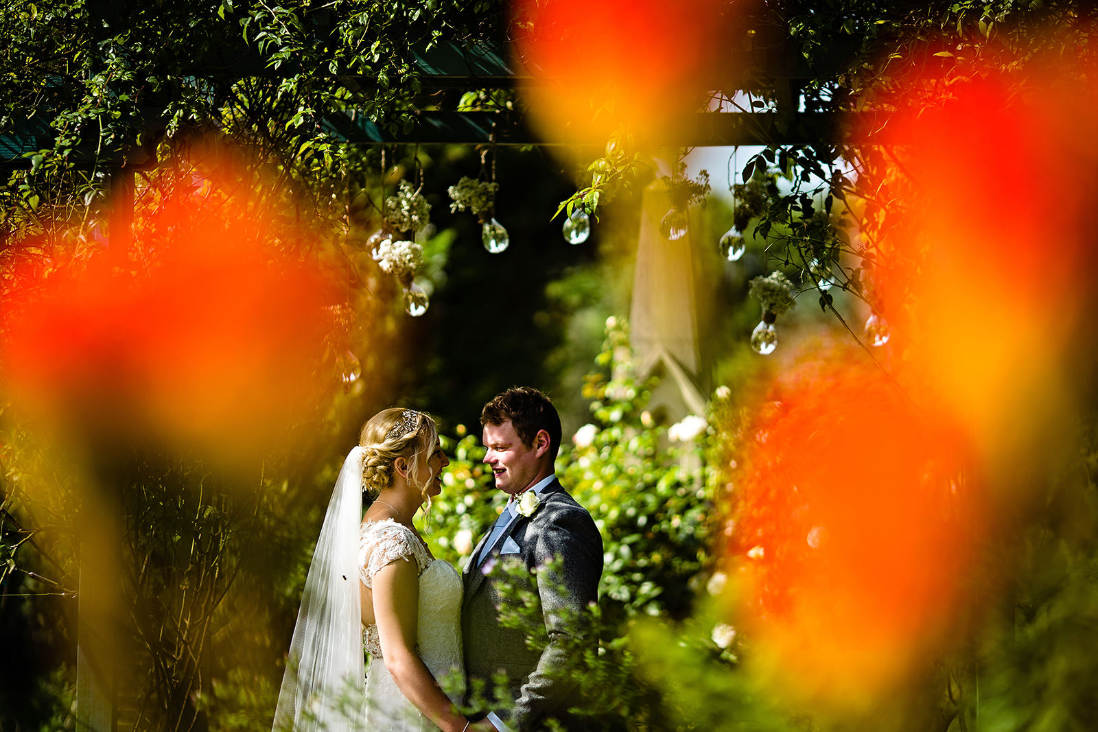 bride and groom with flowers Dunwood Hall Wedding Photography