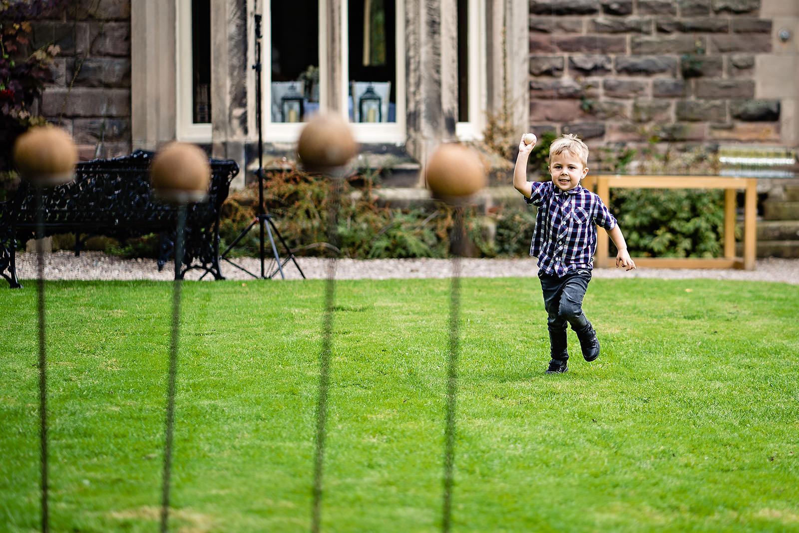 kid throwing coconuts at Dunwood Hall